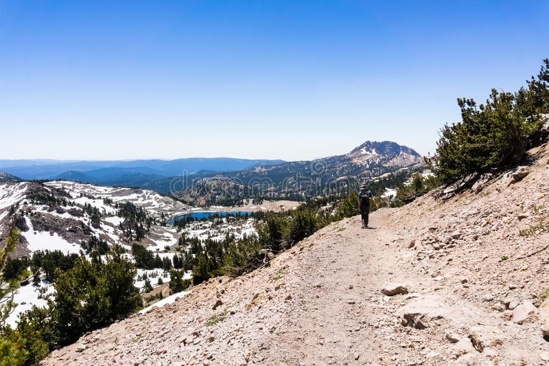 Hiking trail to Lassen Peak, Lake Helen in the background; Lassen Volcanic National Park, Northern California royalty free stock photo