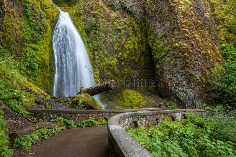 A hiking trail and a waterfall in the Columbia River Gorge stock photo
