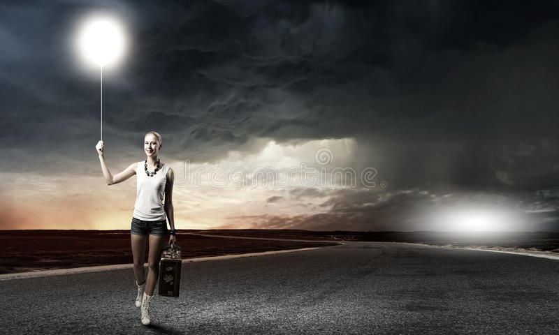 Hiking traveling. Young woman hiker walking with suitcase in hand stock photography