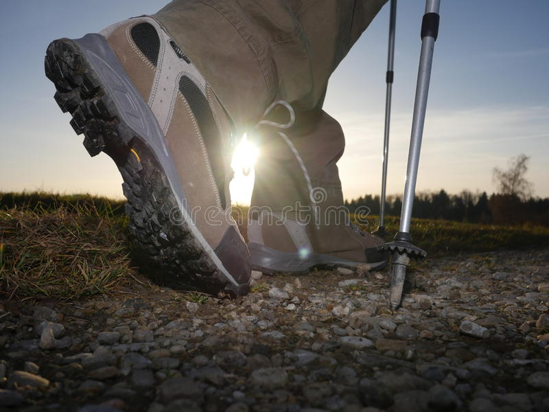 Hiking trekking boots outdoors. Hiking trail with hiking trekking boots outdoors stock photos