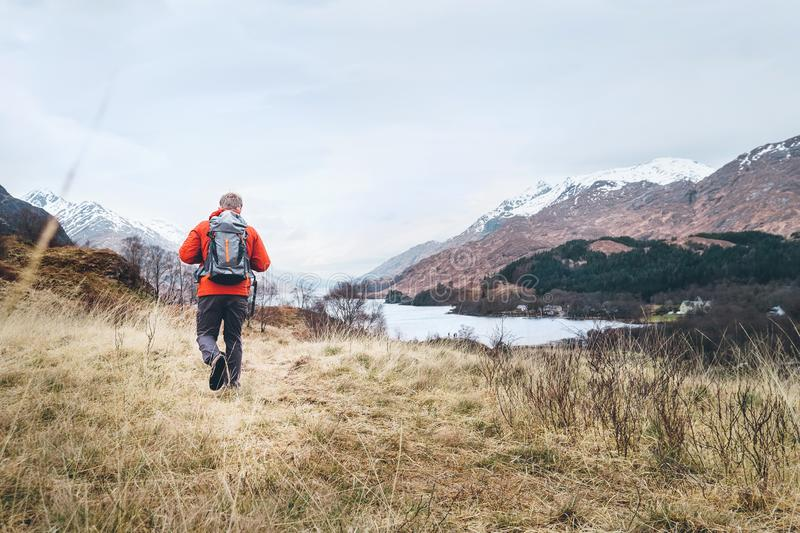 Hiking, walk with backpack, active lifestyle concept image. Traveler with backpack walks among the hills royalty free stock photo