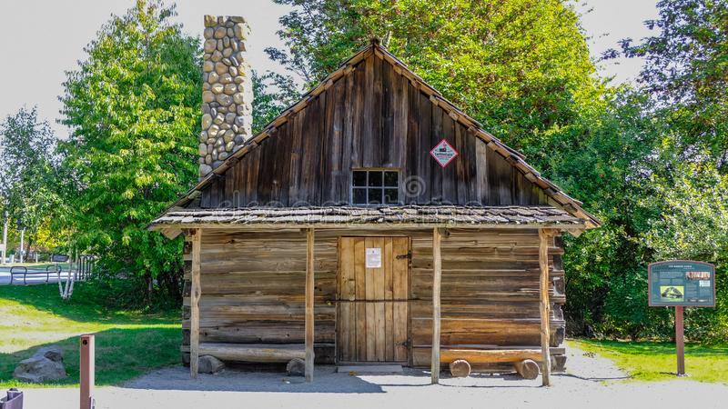 The Oldest Building In Federal Way In The West Hylebos Wetlands Park In Early Autumn, Washington, United States. The old cabin at the entrance of the park that stock photos