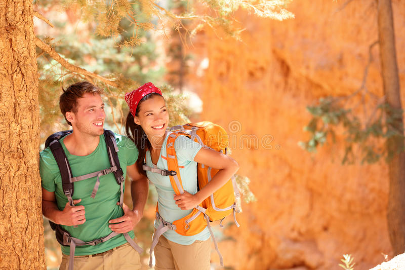 Hiking - young couple of hikers royalty free stock images