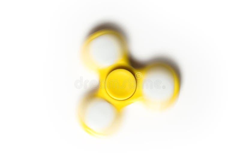 Hilandero amarillo de la persona agitada en el movimiento imagen de archivo
