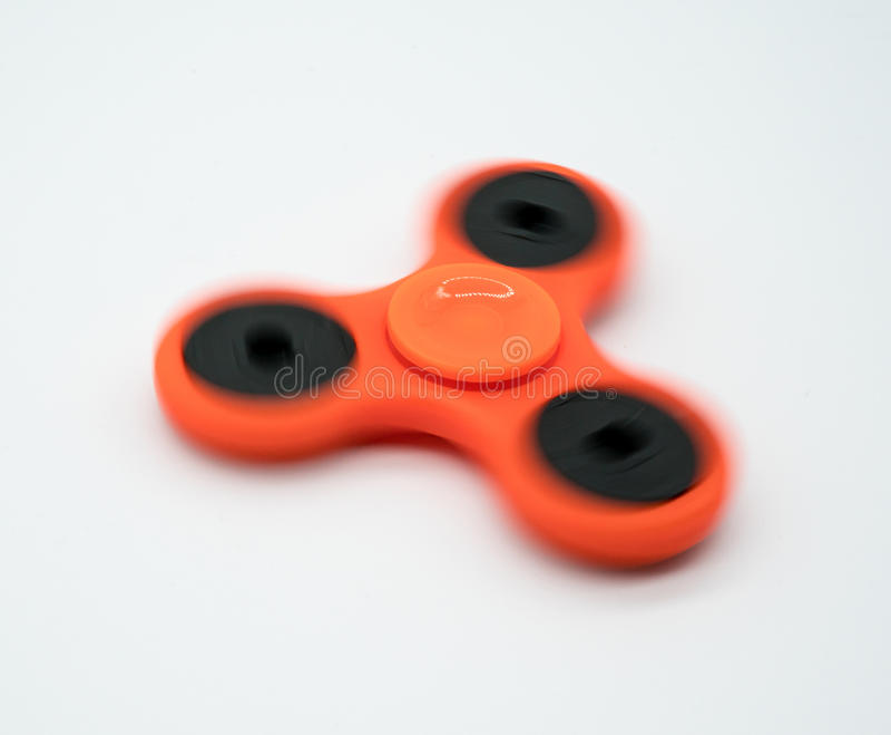 Hilandero anaranjado de giro de la persona agitada fotografía de archivo libre de regalías