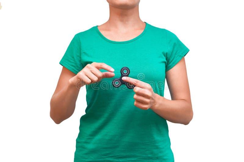Hilandero de la persona agitada de la tenencia de la muchacha en su mano Aislado en el fondo blanco foto de archivo libre de regalías