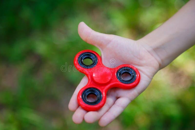 Hilandero plástico rojo popular del finger imagen de archivo