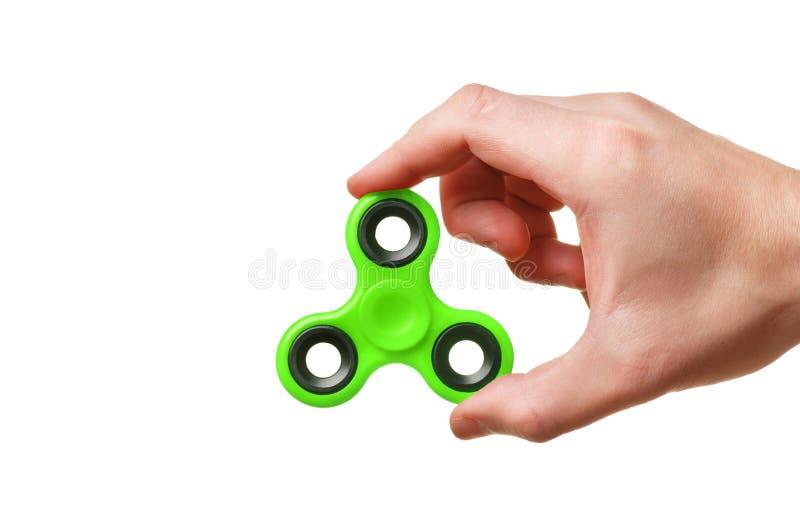 Hilandero verde de la mano aislado fotografía de archivo