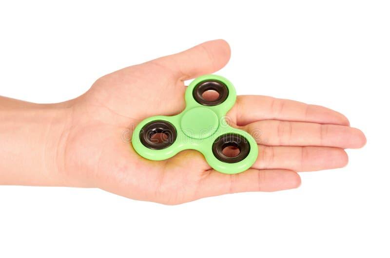 Hilandero verde de la persona agitada a disposición aislado en el fondo blanco imagen de archivo libre de regalías