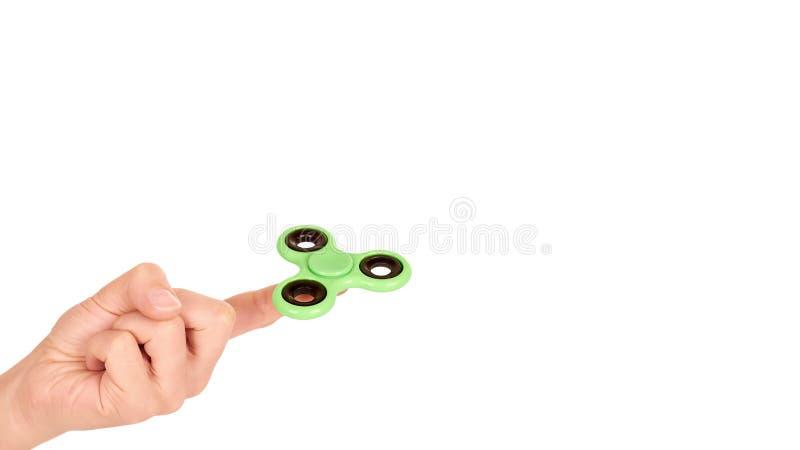 Hilandero verde de la persona agitada a disposición aislado en el fondo blanco copie el espacio, plantilla fotografía de archivo libre de regalías
