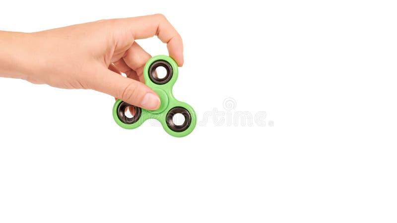 Hilandero verde de la persona agitada a disposición aislado en el fondo blanco copie el espacio, plantilla imagen de archivo libre de regalías