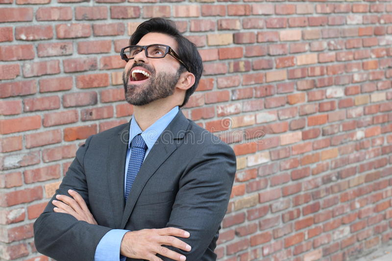 Hilarious businessman looking up with his mouth wide open stock photography