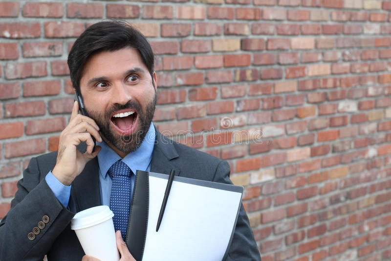 Hilarious cute businessman showing surprise royalty free stock image