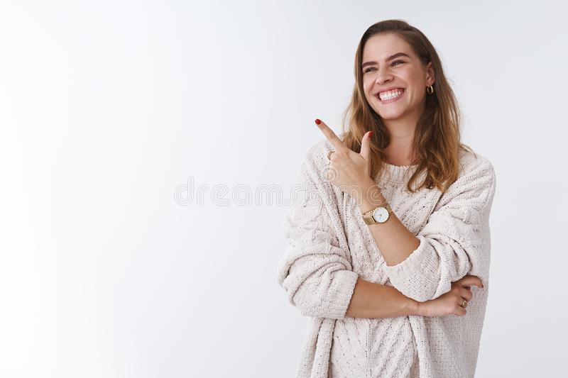 Hilarious scene woman cannot stop laugh. Carefree attractive joyful charming girl turning sideways pointing left corner stock image