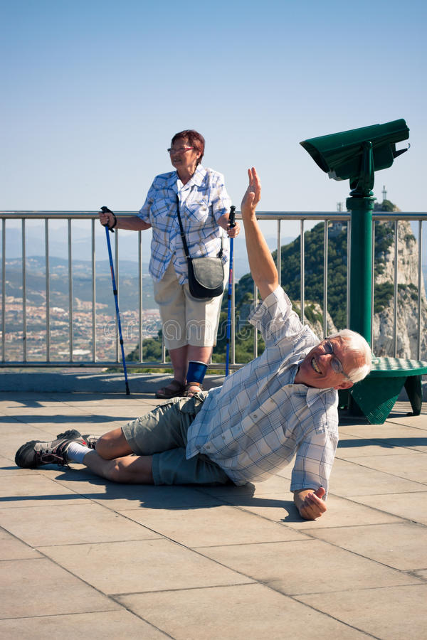 Hilarious senior man tourist on Gibraltar Rock royalty free stock image