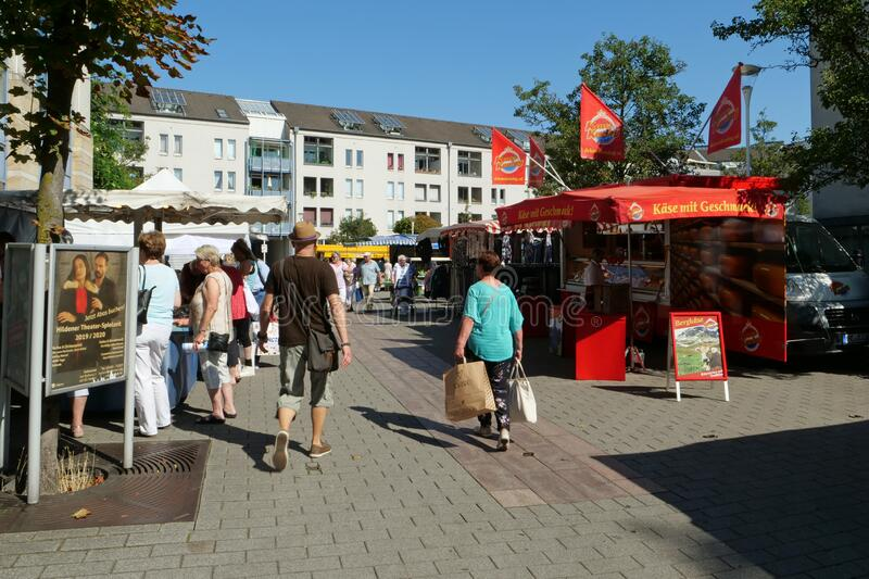 Hilden, Germany, Europe - August 24, 2019: People shopping at the local fresh food market. The city of Hilden belongs to the county of Mettmann in the royalty free stock images
