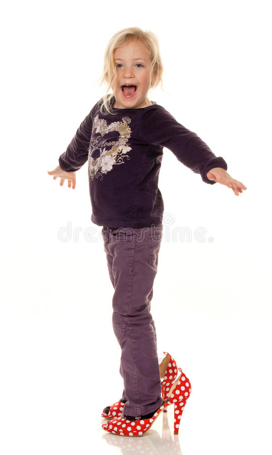 Hildren with big shoes stock photos