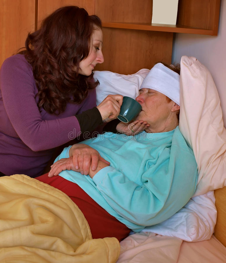 Hilfe für kranke alte Dame 1 lizenzfreies stockbild