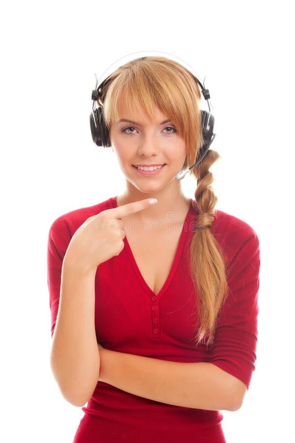 Hilfenzeile Bediener der jungen Frau in den Kopfhörern lizenzfreie stockfotografie