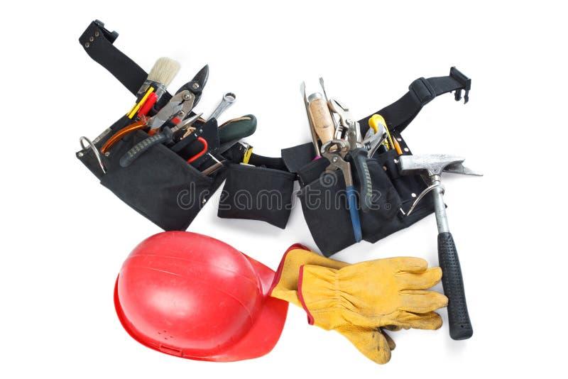 Hilfsmittel schnallen, Sturzhelm und lederner Handschuh um lizenzfreie stockfotografie