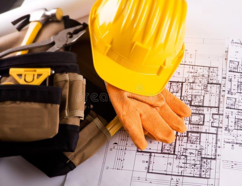 Hilfsmittel und contruction Pläne lizenzfreie stockbilder
