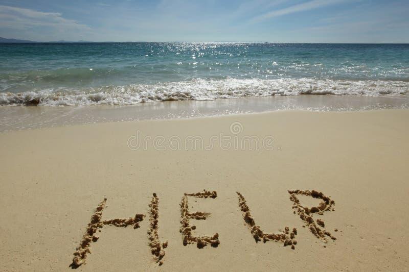 Hilfszeichen auf dem Strand lizenzfreie stockbilder