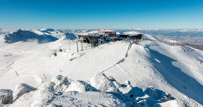 Hill Chopok in Low Tatras mountains, Slovakia. DEMANOVSKA DOLINA, SLOVAKIA - JANUARY 22:  Top of the hill Chopok and cableway station in ski resort Jasna - Low royalty free stock images