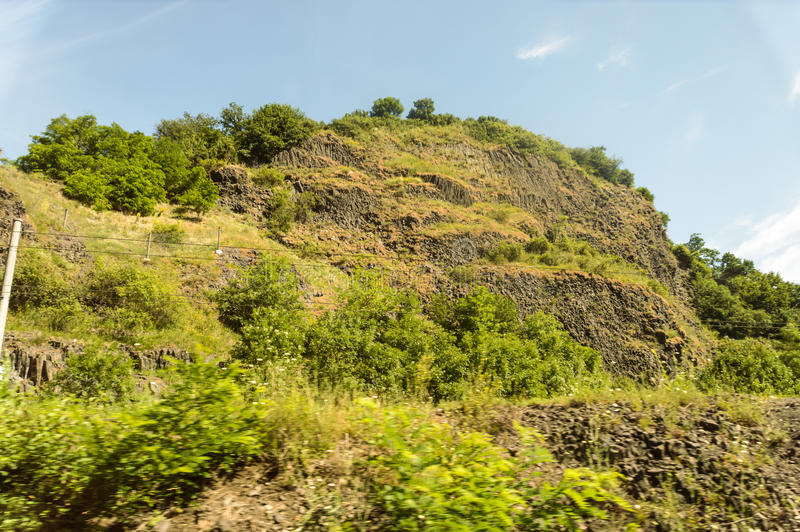 Hill covered with fresh greenery and tiny stone particles. Hill covered with fresh greenery and grass as well as tiny stone particles stock photography