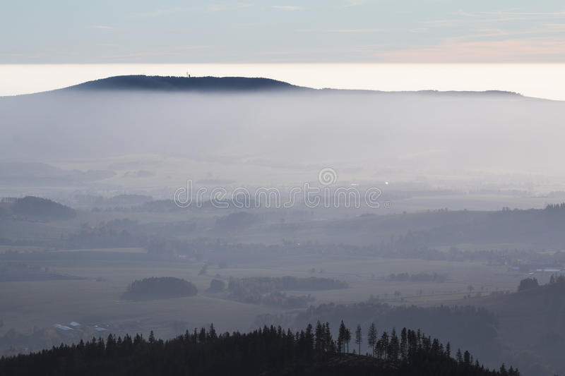 Hill in the fog royalty free stock photography