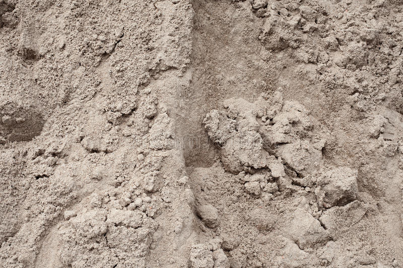 Hill gray building sand close-up. Textural background stock images