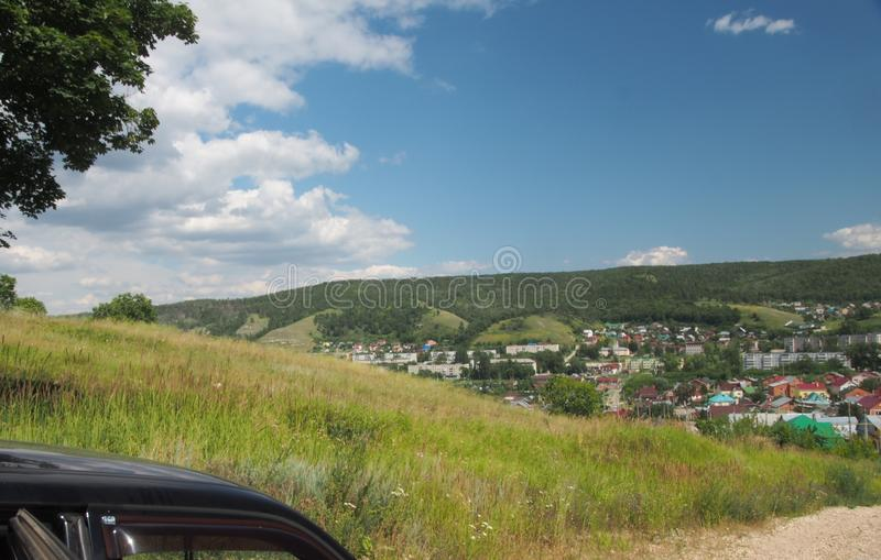 The hill offers a view of the city Zhigulevsk. Urban structure a. The hill offers a view of the city Zhigulevsk. Landscape. Urban structure and nature royalty free stock photography