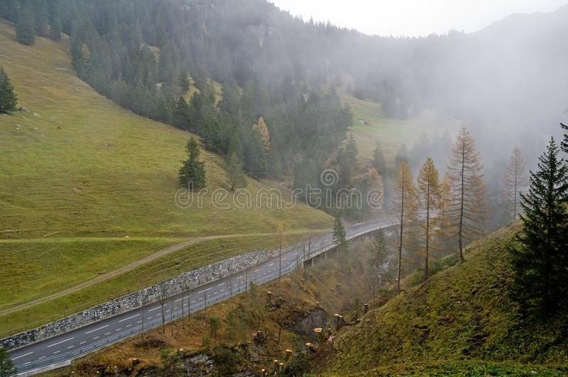 Hill road in cloudy weather. Hill road in cloudy misty weather in Lichtenstein royalty free stock image