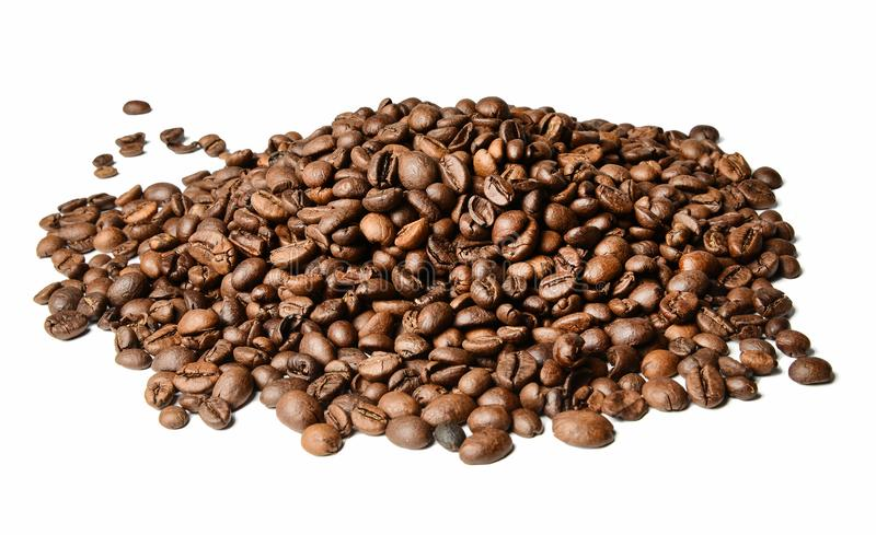 A hill of roasted coffee beans on a white isolated background. Close distance. royalty free stock photos