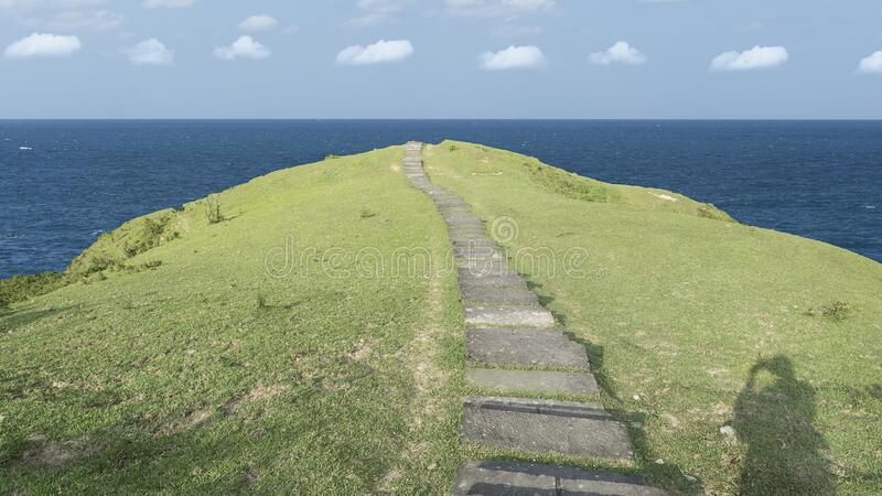 Hill with small road go to the sea with nice view stock images