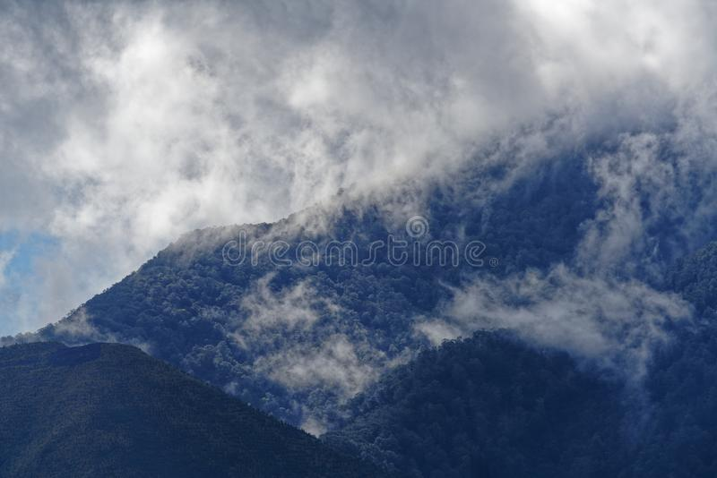Hill tops in the clouds, Marlborough Sounds, New Zealand stock image