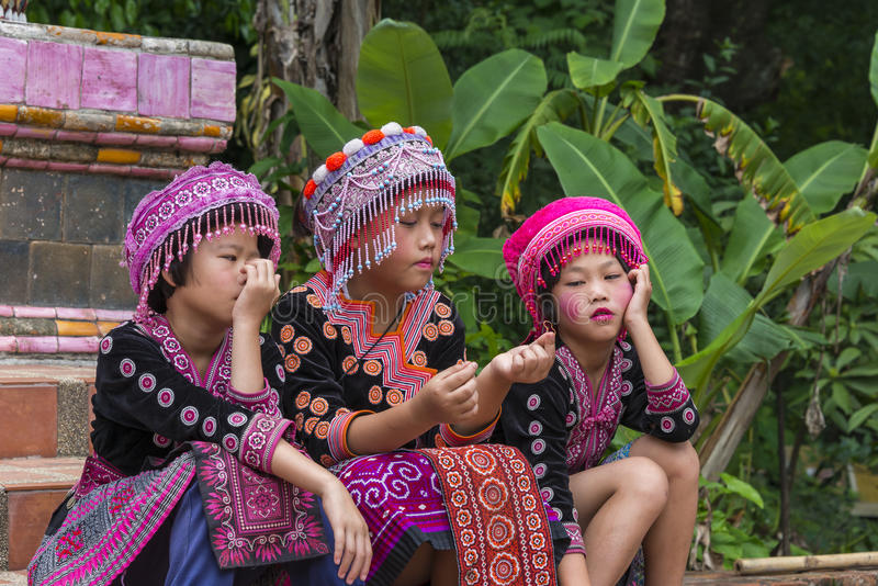 Hill tribe children in traditional clothing at Doi Suthep. Hill tribe children wearing traditional cloths at Wat Phra That Doi Suthep temple in Chiang Mai royalty free stock photo