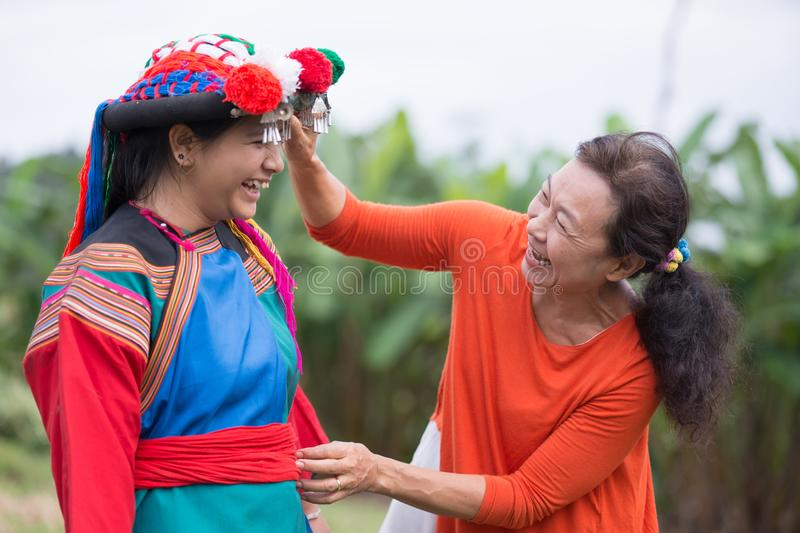 Happy Hill tribe woman in colorful costume dress. Hill tribe women in colorful costume dress smile happiness family. Lifestyle of countryside of minority in royalty free stock images