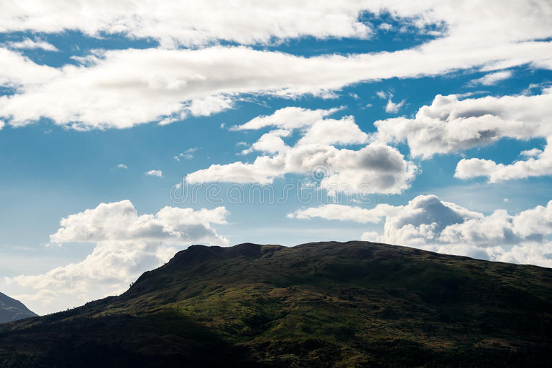 Hill under blue sky. Green hill under a blue cloudy sky in Subic bay philippines stock photos