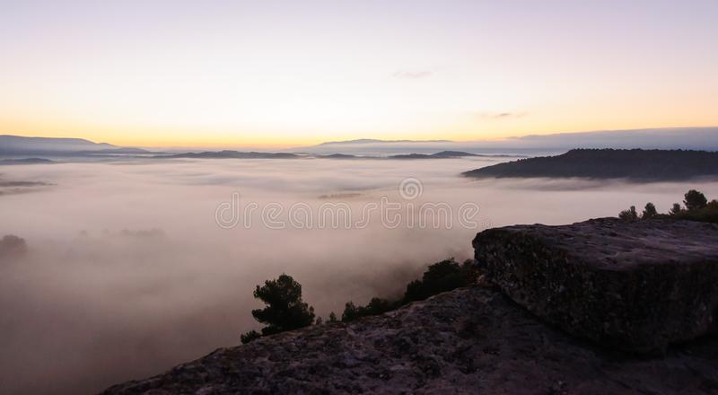 Hill village rising out of the clouds stock photo