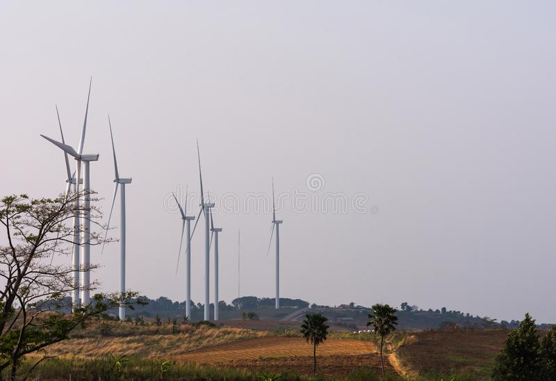 Hill of wind turbines stock images