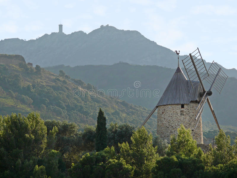 Hill and windmill royalty free stock images