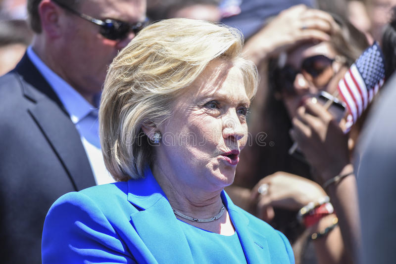 Hillary Greets Supporters. Hillary Clinton in direct sunlight chats with supporters on Roosevelt Island after announcing her candidacy for the 2016 Democratic royalty free stock photo