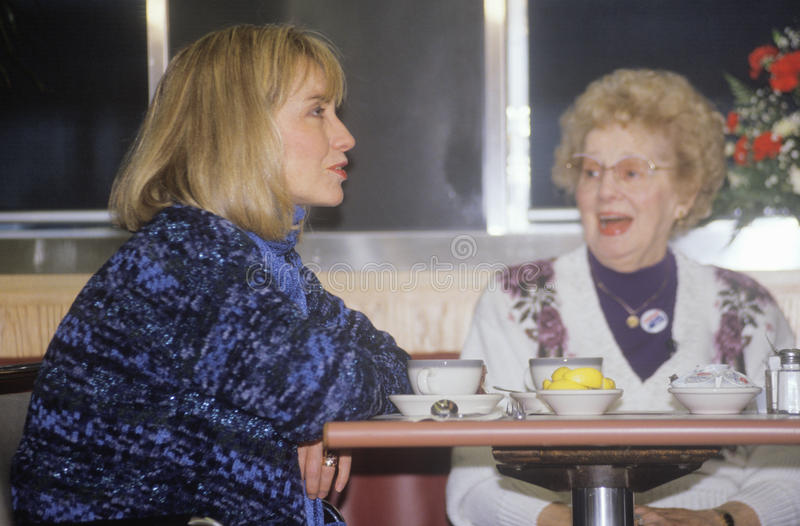 Hillary Rodham Clinton meets with townspeople. At the Mayfield Diner in 1992 on Bill Clinton's final day of campaigning in Philadelphia, Pennsylvania stock photo