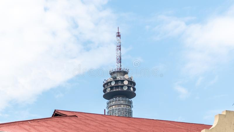 Hillbrow TV Tower over downtown Johannesburg, South Africa. Johannesburg, South Africa - October 2019: Hillbrow TV Tower over downtown Johannesburg in South stock photos