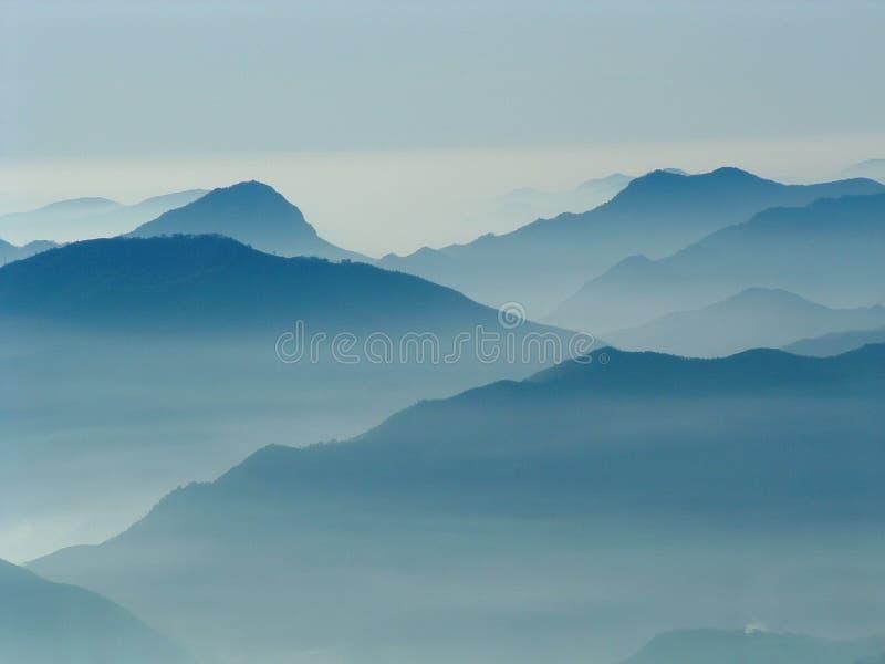 hills among the clouds stock photos