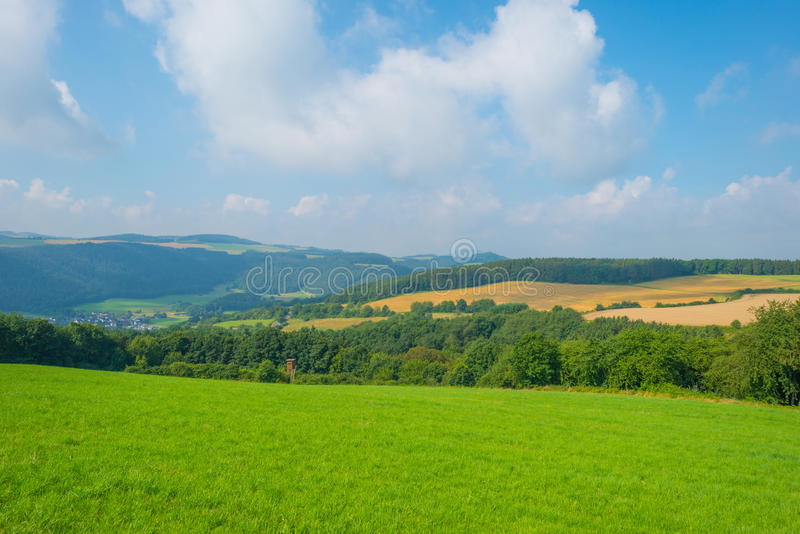 Hills of the Eifel National Park in sunlight. Hills of the Eifel National Park in summer stock photos