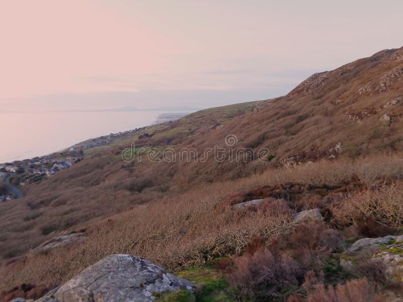 View towards Shell Island on a nice evening. Looking along the slope of hills with Cardigan Bay off to the left and Shell Island off in the distance royalty free stock image