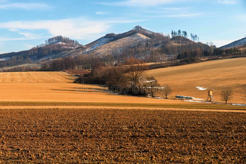Hills and fields near Podhradni Lhota, Czech republic. Picturesque hills and fields near Podhradni Lhota Moravia, Czech republic, in winter sunny day with snow stock image