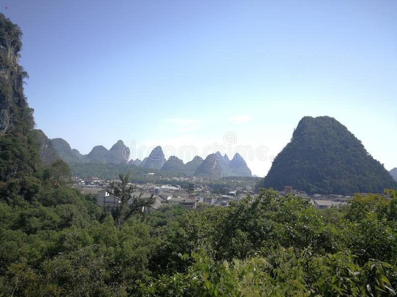 The hills of guilin. Guilin landscape, under the blue sky, rolling mountains from the ground, marveled at the charm of nature royalty free stock image