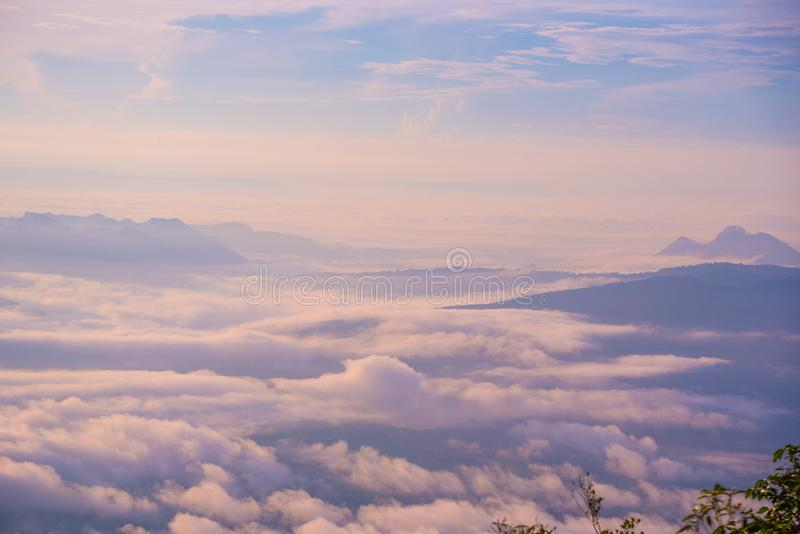 Hills increased from fog Sunrise morning Beautiful royalty free stock photography